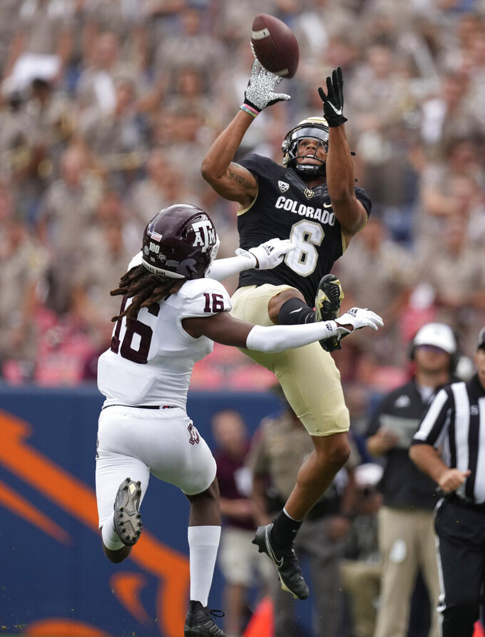 Colorado wide receiver Daniel Arias, right, misses a pass as Texas A&M defensive back Brian George defends in the second half of an NCAA college football game Saturday, Sept. 11, 2021, in Denver. Texas A&M won 10-7. (AP Photo/David Zalubowski)