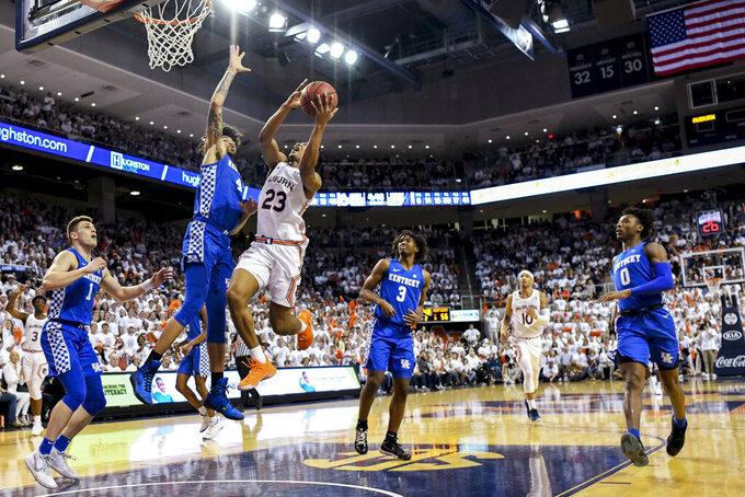 Kentucky forward Nick Richards (4) defends against a shot by Auburn forward Isaac Okoro (23) during the second half of an NCAA college basketball game Saturday, Feb. 1, 2020, in Auburn, Ala. (AP Photo/Julie Bennett)