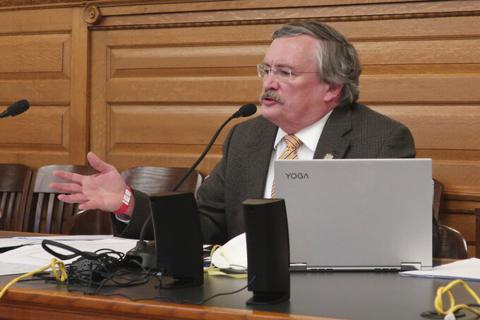 """FILE - In this Thursday, May 21, 2020 file photo, state Rep. John Carmichael, D-Wichita, speaks during negotiations between the House and Senate over the final contents of a bill that would limit Democratic Gov. Laura Kelly's power to direct the state's response to the coronavirus pandemic, at the Statehouse in Topeka, Kan. """"The power of the executive has been emasculated when it comes to the Emergency Management Act,"""" Carmichael says. """"That may have very dire consequences in other circumstances and other disasters."""" (AP Photo/John Hanna)"""