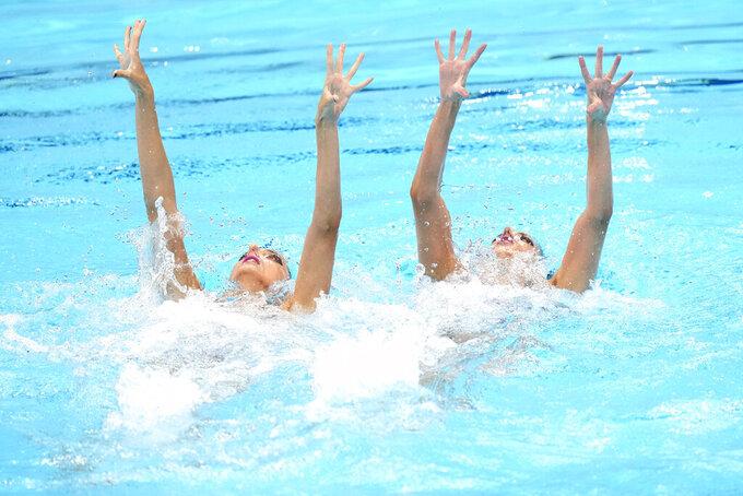 Anna-Maria Alexandri and Eirini Alexandri, of Austria compete in the Duet Free Routine Preliminary at the Tokyo Aquatics Centre at the 2020 Summer Olympics, Monday, Aug. 2, 2021, in Tokyo, Japan. (AP Photo/Alessandra Tarantino)
