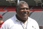 "FILE - In this April 2, 2014, file photo, Houston Texans defensive coordinator Romeo Crennel smiles at South Carolina football pro day in Columbia, S.C. The late Bill Arnsparger and Houston associate head coach Romeo Crennel have won the Paul ""Dr. Z"" Zimmerman award from the Professional Football Writers of America, started by the PFWA in 2014 to recognize lifetime achievement among assistant coaches.   (AP Photo/Mary Ann Chastain, File)"