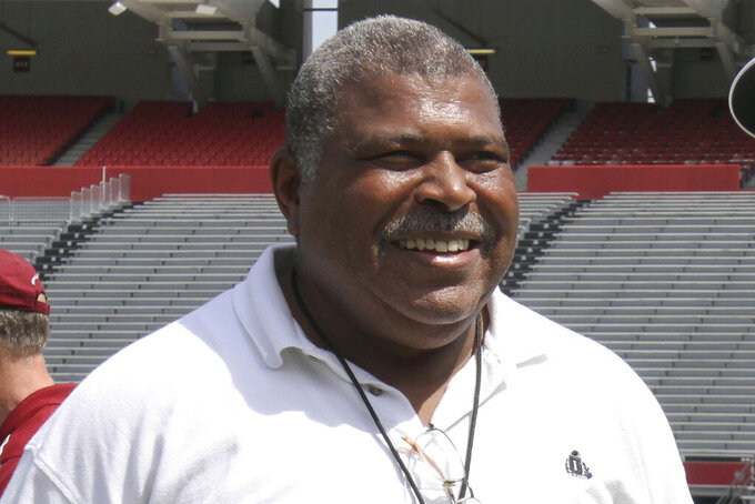 """FILE - In this April 2, 2014, file photo, Houston Texans defensive coordinator Romeo Crennel smiles at South Carolina football pro day in Columbia, S.C. The late Bill Arnsparger and Houston associate head coach Romeo Crennel have won the Paul """"Dr. Z"""" Zimmerman award from the Professional Football Writers of America, started by the PFWA in 2014 to recognize lifetime achievement among assistant coaches.   (AP Photo/Mary Ann Chastain, File)"""