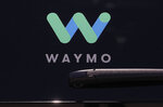 FILE - This Tuesday, May 8, 2018, file photo shows a Waymo logo displayed on the window of a car at the Google I/O conference in Mountain View, Calif. Google autonomous vehicle spinoff Waymo says it will start testing on public roads in Florida in August 2019 to better experience heavy rain. The Mountain View, California, company says tests will include highway driving to Orlando, Tampa and Fort Myers. (AP Photo/Jeff Chiu, File)