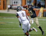 Wake Forest quarterback Sam Hartman, right, throws a touchdown pass against Towson defensive back Monty Fenner in the first half of a NCAA college football game in Winston-Salem, N.C., Saturday, Sept. 8, 2018. (AP Photo/Nell Redmond)