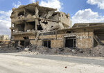 A building damaged by Syrian government forces following clashes with rebel fighters is seen in the southern city of Daraa, Syria, Sunday, Sept 12, 2021. A Russian-negotiated deal went into effect last week to end a government siege and intense fighting in the city of Daraa and with rebel fighters holed up Daraa al-Balad forcing some of them to go to the rebel-held north and others to surrender their weapons in return for amnesty. (AP Photo)