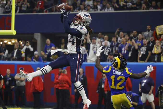 New England Patriots' Stephon Gilmore (24) intercepts a pass intended for Los Angeles Rams' Brandin Cooks (12), during the second half of the NFL Super Bowl 53 football game Sunday, Feb. 3, 2019, in Atlanta.. (AP Photo/Matt Rourke)