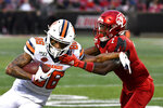 Syracuse wide receiver Trishton Jackson (86) is grabbed by Louisville defensive back Chandler Jones (2) during the first half of an NCAA college football game in Louisville, Ky., Saturday, Nov. 23, 2019. (AP Photo/Timothy D. Easley)
