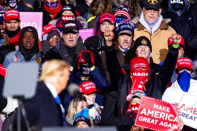 Supporters cheer as President Donald Trump speaks during a rally Tuesday, Oct. 27, 2020, in Omaha, Neb. Several people were taken to hospitals after the rally for President Trump that drew thousands, many of whom were left stranded miles from their parked cars in freezing weather. (Anna Reed/The World-Herald via AP)