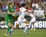 U.S. forward Carli Lloyd, right, battles for the ball with Ireland defender Louise Quinn during the first half of an international friendly soccer match in Pasadena, Calif., Saturday, Aug. 3, 2019. (AP Photo/Alex Gallardo)