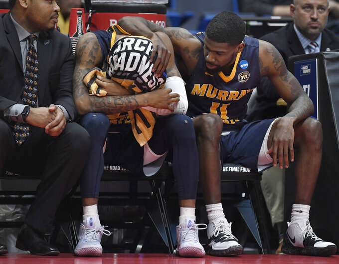 Murray State's Ja Morant, left is consoled by teammate Murray State's Shaq Buchanan, right, during the second half of a second round men's college basketball game against Florida State in the NCAA tournament, Saturday, March 23, 2019, in Hartford, Conn. (AP Photo/Jessica Hill)