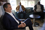 FILE - In this Jan. 14, 2020 file photo California Gov. Gavin Newsom, left, visits the Lone Star Board and Care, in Los Angeles. Nonprofit health care system Kaiser Permanente today announced it will be the first private sector contributor to Newsom's newly announced fund to combat homelessness in the state, committing $25 million to the effort. (Francine Orr/Los Angeles Times via AP, Pool,File)