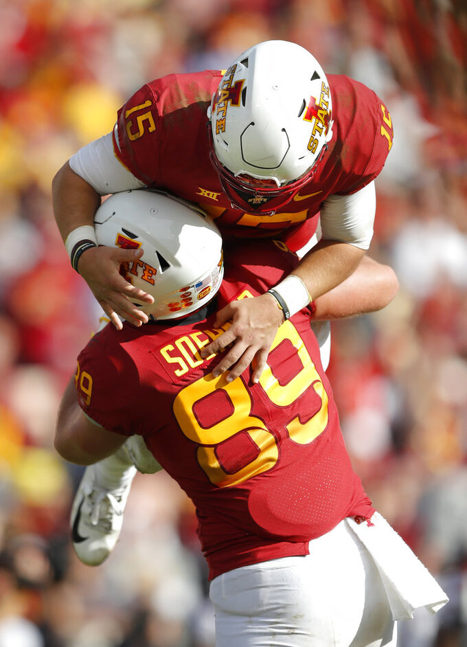Iowa State quarterback Brock Purdy (15) celebrates with teammate Dylan Soehner (89) at the end of an NCAA college football game against Texas Tech, Saturday, Oct. 27, 2018, in Ames, Iowa. Iowa State won 40-31. (AP Photo/Charlie Neibergall)