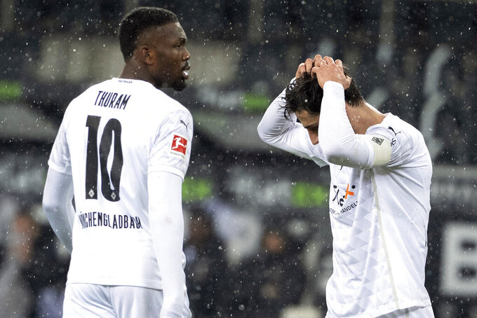 Gladbach's Lars Stindl, right, and Marcus Thuram react disappointed during the German Bundesliga soccer match between Borussia Moenchengladbach and 1.FC Cologne in Moenchengladbach, Saturday, Feb. 6, 2021. (Federico Gambarini/Pool via AP)