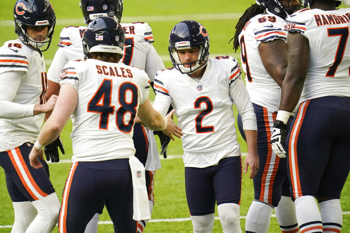 Chicago Bears place kicker Cairo Santos (2) celebrates with teammates after kicking a 35-yard field goal during the first half of an NFL football game against the Minnesota Vikings, Sunday, Dec. 20, 2020, in Minneapolis. (AP Photo/Jim Mone)