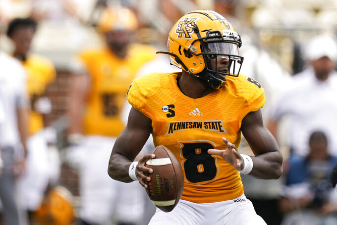 Kennesaw State quarterback Xavier Shepherd (8) looks to pass against Georgia Tech during the first half of an NCAA college football game, Saturday, Sept. 11, 2021, in Atlanta. (AP Photo/Brynn Anderson)