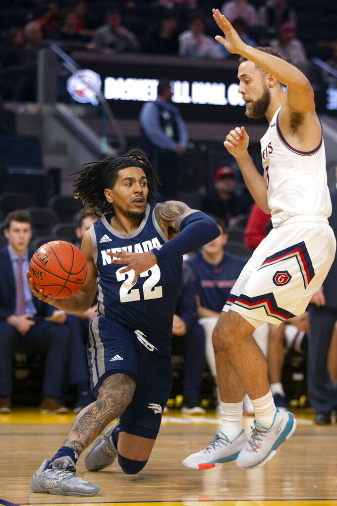 Nevada guard Jazz Johnson (22) looks to pass the ball around Saint Mary's guard Jordan Ford (3) during the first half of an NCAA college basketball game Saturday, Dec. 21, 2019, in San Francisco. (AP Photo/D. Ross Cameron)