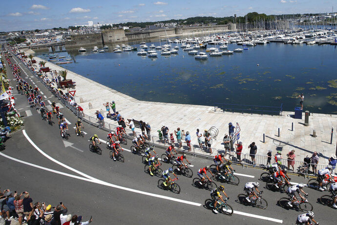 The pack passes through Concarneau during the fifth stage of the Tour de France cycling race over 204.5 kilometers (127 miles) with start in Lorient and finish in Quimper, France, Wednesday, July 11, 2018. (AP Photo/Christophe Ena )