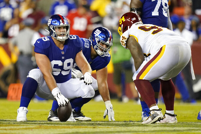 New York Giants center Billy Price (69) lines up against Washington Football Team nose tackle Daron Payne (94) during the second half of an NFL football game, Thursday, Sept. 16, 2021, in Landover, Md. (AP Photo/Patrick Semansky)