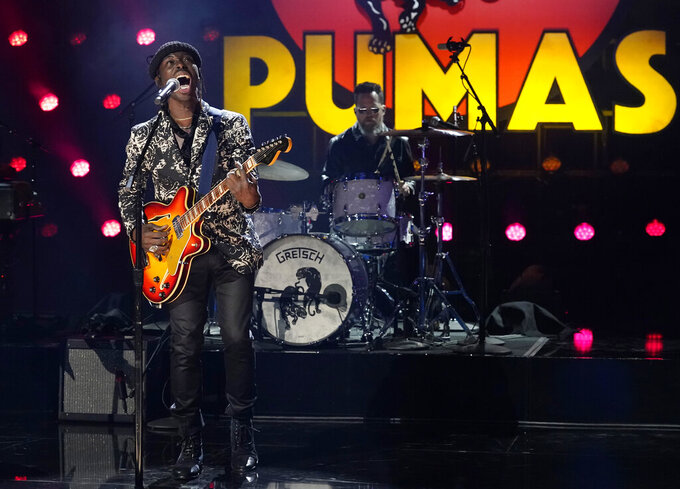 """FILE - Eric Burton of Black Pumas performs """"Colors"""" at the 63rd Grammy Awards at the Los Angeles Convention Center, in this Thursday, March 11, 2021, file photo. Grammy Award nominated rock & soul duo Black Pumas and Cleveland's own Machine Gun Kelly will perform at next week's NFL draft. The league announced its musical acts for the second and third days of the draft, which is back on the road after being all virtual last year due to the COVID-19 pandemic. (AP Photo/Chris Pizzello, File)"""