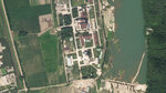 In this satellite photo released by Planet Labs Inc., North Korea's main nuclear complex is seen in Yongbyon, North Korea, just north of the capital, Pyongyang, July 27, 2021. North Korea appears to have restarted the operation of its main nuclear reactor used to produce weapons fuels, the U.N. atomic agency said, as the North openly threatens to enlarge its nuclear arsenal amid long-dormant nuclear diplomacy with the United States. In the image, North Korea's 5-megawatt nuclear reactor is seen to the building to the north, while the experimental light water reactor is the building with the circular feature atop it to the south. (Planet Labs Inc. via AP)