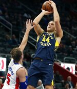 Indiana Pacers forward Bojan Bogdanovic (44) shoots as Detroit Pistons guard Luke Kennard (5) defends during the second half of an NBA basketball game, Wednesday, April 3, 2019, in Detroit. (AP Photo/Carlos Osorio)