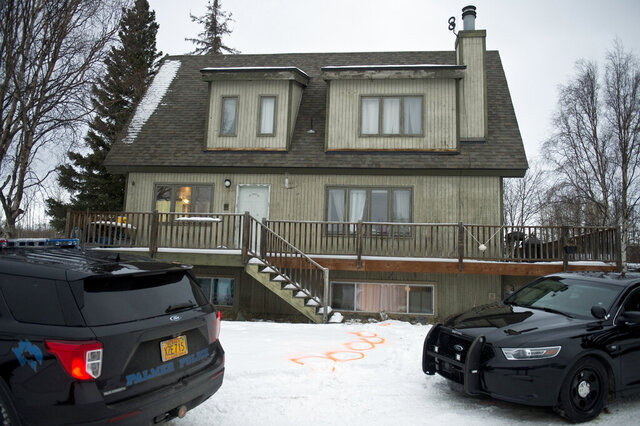 Alaska State Troopers investigate a fatal shooting scene at a home on North Valley Way in Palmer, Alaska, Monday, Nov. 30, 2020. An 18-year-old Alaska man just out of jail for assaulting a family member has been charged with killing four members of his family, including two cousins under the age of 10, charging documents released Tuesday, Dec. 1, 2020 said. (Marc Lester/Anchorage Daily News via AP)