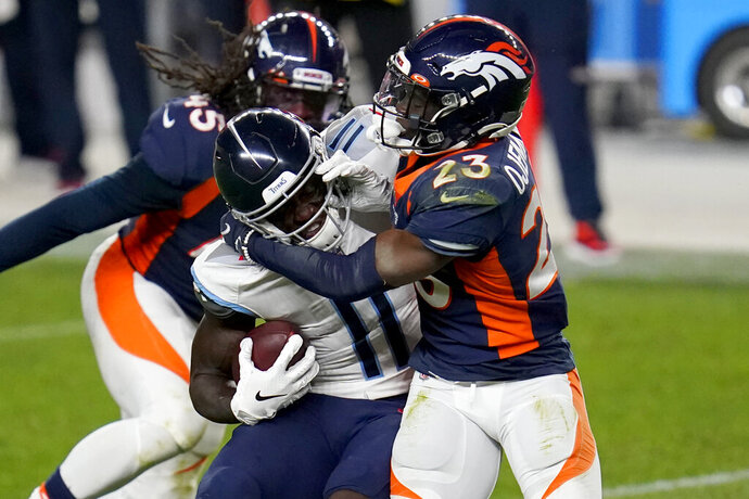 Tennessee Titans wide receiver A.J. Brown (11) is hit by Denver Broncos cornerback Michael Ojemudia (23) during the second half of an NFL football game, Monday, Sept. 14, 2020, in Denver. (AP Photo/David Zalubowski)
