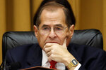 """FILE - In this July 24, 2019, file photo, House Judiciary Committee Chairman Jerrold Nadler, D-N.Y., listens as former special counsel Robert Mueller testifies before the House Judiciary Committee on Capitol Hill, in Washington. The messages coming from House Democrats on impeachment in recent weeks are decidedly confusing. House Speaker Nancy Pelosi has said Democrats need to wait for court decisions before they decide whether to approve articles of impeachment. At the same time, Nadler, said Aug. 8 that what his committee is doing now amounts to """"formal impeachment proceedings"""" _ and that Democrats will make a final decision by the end of the year. (AP Photo/Alex Brandon, File)"""