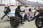 Kyle Busch makes a pit stop during the NASCAR Xfinity series auto race Thursday, May 21, 2020, in Darlington, S.C. (AP Photo/Brynn Anderson)
