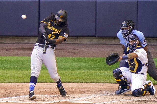 Pittsburgh Pirates' Josh Bell hits a two-run home run during the fourth inning of a baseball game against the Milwaukee Brewers Sunday, Aug. 30, 2020, in Milwaukee. (AP Photo/Morry Gash)