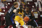 Saint Louis's Andre Lorentsson (13) handles the ball against Minnesota's Both Gach (11) during an NCAA college basketball game Sunday, Dec. 20, 2020, in Minneapolis. (AP Photo/Stacy Bengs)