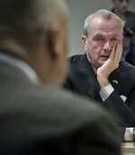 New Jersey Gov. Phil Murphy, center, listen during a hearing on the Gateway Project before a Congressional delegation at Port Authority headquarters, Friday May 3, 2019, in New York. (AP Photo/Bebeto Matthews)