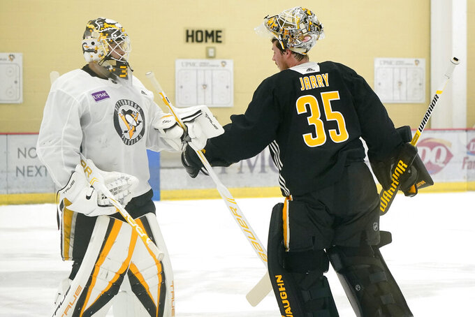 Pittsburgh Penguins goalies Tristan Jarry (35) and Alex D'Orio participates in the team's first NHL hockey practice of the season in Cranberry Township, Pa., Thursday, Sept. 23, 2021. (AP Photo/Gene J. Puskar)