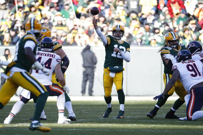 Green Bay Packers' Aaron Rodgers throws during the first half of an NFL football game against the Chicago Bears Sunday, Dec. 15, 2019, in Green Bay, Wis. (AP Photo/Matt Ludtke)