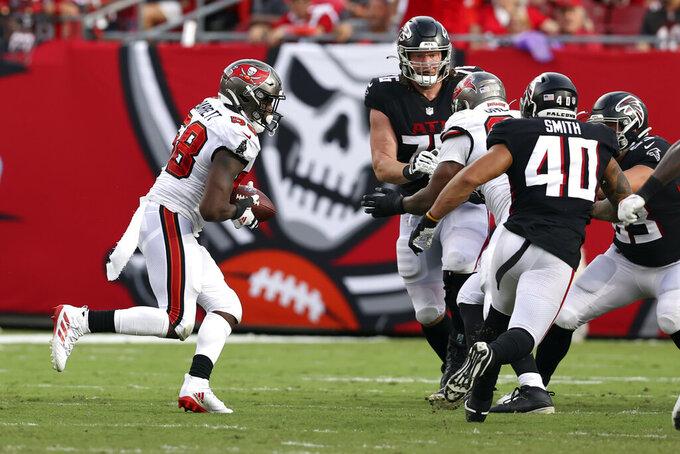 Tampa Bay Buccaneers linebacker Shaquil Barrett (58) intercepts a pass by Atlanta Falcons quarterback Matt Ryan during the second half of an NFL football game Sunday, Sept. 19, 2021, in Tampa, Fla. (AP Photo/Mark LoMoglio)