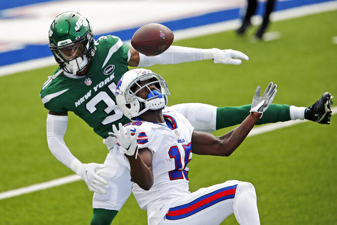 New York Jets cornerback Blessuan Austin (31) breaks up a pass intended for Buffalo Bills wide receiver John Brown (15) during the first half of an NFL football game in Orchard Park, N.Y., Sunday, Sept. 13, 2020. (AP Photo/Jeffrey T. Barnes)