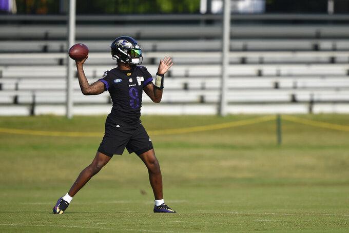 Baltimore Ravens quarterback Lamar Jackson throws during an NFL football practice, Monday, Aug. 9, 2021 in Owings Mills, Md.(AP Photo/Gail Burton)
