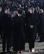 Dutch Prime Minister Mark Rutte, Queen Maxima and King Willem-Alexander pay their respects at the Auschwitz Nazi death camp in Oswiecim, Poland, Monday, Jan. 27, 2020. Survivors of the Auschwitz-Birkenau death camp gathered for commemorations marking the 75th anniversary of the Soviet army's liberation of the camp, using the testimony of survivors to warn about the signs of rising anti-Semitism and hatred in the world today. (AP Photo/Czarek Sokolowski)