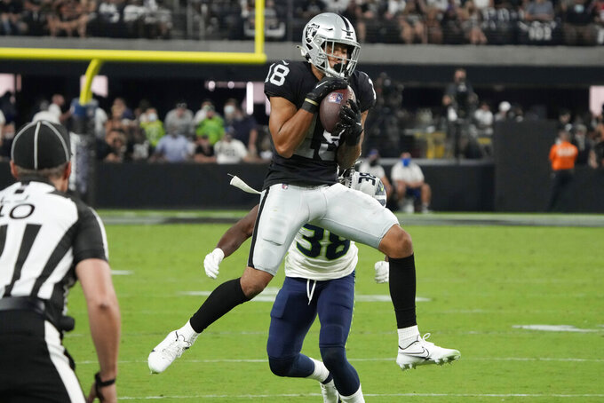 Las Vegas Raiders wide receiver Keelan Doss (18) makes a catch against the Seattle Seahawks during the first half of an NFL preseason football game, Saturday, Aug. 14, 2021, in Las Vegas. (AP Photo/Rick Scuteri)