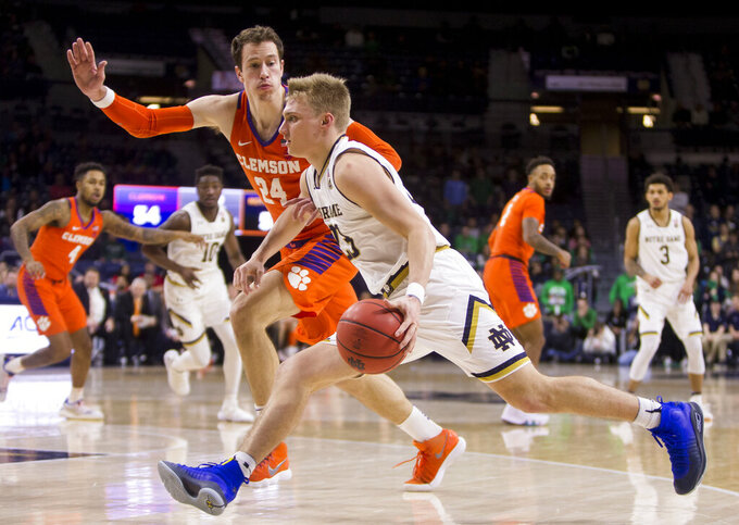 Notre Dame's Dane Goodwin (23) drives by Clemson's David Skara (24) during the second half of an NCAA college basketball game Wednesday, March 6, 2019, in South Bend, Ind. Clemson won 64-62. (AP Photo/Robert Franklin)