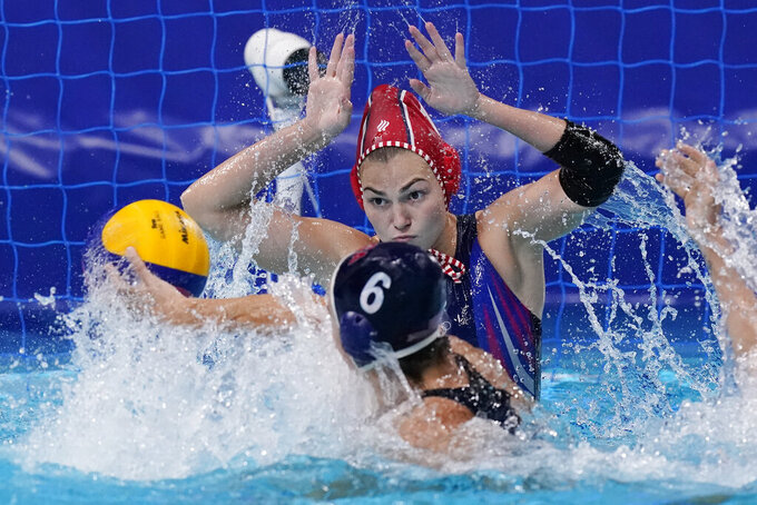 Goalkeeper Evgeniia Golovina, of the Russian Olympic Committee, follows a shot by United States' Margaret Steffens (6) during a semifinal round women's water polo match at the 2020 Summer Olympics, Thursday, Aug. 5, 2021, in Tokyo, Japan. (AP Photo/Mark Humphrey)