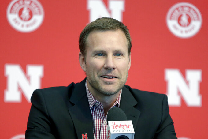 FILE - In this April 2, 2019, file photo, Fred Hoiberg smiles as he is introduced as Nebraska's new NCAA college basketball head coach at a news conference in Lincoln, Neb. Nebraska football coach Scott Frost and men's basketball coach Fred Hoiberg will donate a portion of their salaries to the athletic department's general operating fund to help offset revenue shortfalls because of the coronavirus pandemic. The athletic department said in a statement Thursday, June 18, 2020, the amount of the donations would be determined when the 2021 budget is closer to being finalized. Frost's salary is $5 million this year. Hoiberg is set to earn $3 million. (AP Photo/Nati Harnik, File)