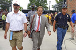 Alabama head coach Nick Saban, center, arrives at Williams-Brice Stadium before the start of an NCAA college football game against South Carolina Saturday, Sept. 14, 2019, in Columbia, S.C. (AP Photo/Richard Shiro)