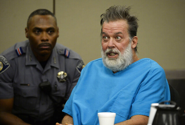 FILE - In this Dec. 9, 2015 file photo, Robert Lewis Dear talks to Judge Gilbert Martinez during a court appearance in Colorado Springs, Colo. Dear, who has been ruled mentally incompetent to stand trial in state court in the killing of three people at a Colorado Planned Parenthood Clinic in 2015 is now facing federal charges. U.S. Attorney Jason Dunn in Denver announced the federal grand jury indictment Monday, Dec. 9, 2019 against Robert Dear in the shooting at a Colorado Springs Planned Parenthood clinic.  (Andy Cross/The Denver Post via AP, Pool, File)