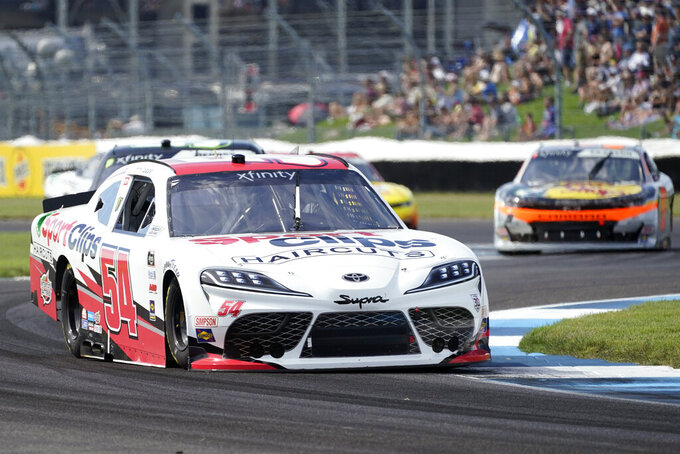Ty Gibbs drives into a turn during a NASCAR Xfinity Series auto race at Indianapolis Motor Speedway, Saturday, Aug. 14, 2021, in Indianapolis. (AP Photo/Darron Cummings)