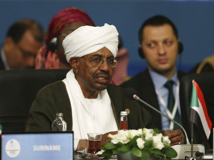 FILE -  In this May 18, 2018, file photo, Sudan's President Omar al-Bashir speaks during the extraordinary summit of the Organization of Islamic Cooperation (OIC), in Istanbul, Turkey.  Sudan's armed forces were to deliver an