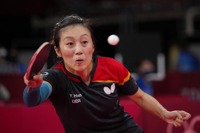 Germany's Han Ying competes during the table tennis women's singles round of 16 match against Singapore's Feng Tianwei at the 2020 Summer Olympics, Tuesday, July 27, 2021, in Tokyo. (AP Photo/Kin Cheung)