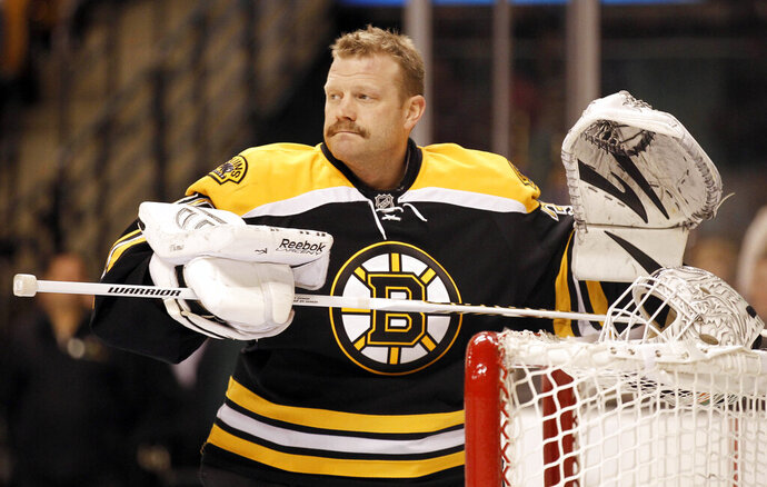 FILE - In this Feb. 4, 2012, file photo, Boston Bruins goalie Tim Thomas is shown before an NHL hockey game agains the Pittsburgh Penguins in Boston. Tim Thomas broke a years-long public silence Wednesday, Sept. 4, 2019,  after being named as part of the United States Hockey Hall of Fame's class of 2019. The mercurial retired NHL goaltender who led the Boston Bruins to the Stanley Cup in 2011 and made headlines for refusing to visit then-President Barack Obama at the White House has avoided the spotlight since walking away from hockey in 2014. (AP Photo/Winslow Townson, File)
