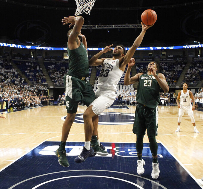 Penn State's Josh Reaves (23) goes to the basket as Michigan State's Nick Ward (44) defends during first-half action of an NCAA college basketball game in State College, Pa. Sunday, Jan. 13, 2019. (AP Photo/Chris Knight)