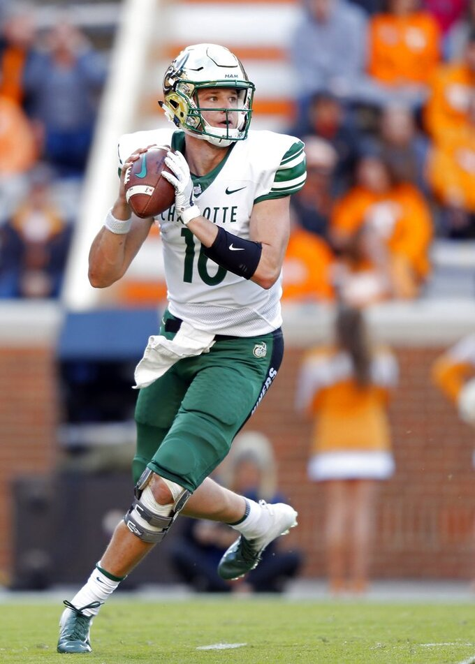 Charlotte quarterback Evan Shirreffs (16) drops back to pass in the first half of an NCAA college football game against Tennessee Saturday, Nov. 3, 2018, in Knoxville, Tenn. (AP Photo/Wade Payne)
